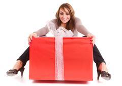 woman receiving big gift - stock photo