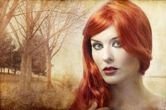 Beautiful redheaded woman on a background of forest, renaissance Stock Photos