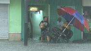 Stock Video Footage of People Struggle In Flood Waters Inundating Building