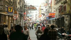 Locals on a busy street in Shanghai Stock Footage