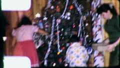 People Trim CHRISTMAS TREE Family Decorates 1960s Vintage Film Home Movie 3181 Stock Footage