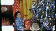 Woman HANDS OUT PRESENTS Christmas Morning 1950s Vintage Film Home Movie 3183 Stock Footage