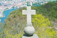 view of lugano from san salvatore mountain with a cross in front - stock photo
