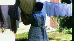 WOMAN HANGS LAUNDRY Clothes Line Housework 1960s Vintage Film Home Movie 3200 Stock Footage