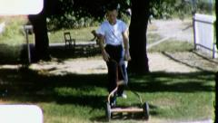Boy Cutting Grass Push Mower Lawn 1960s Vintage Retro Film Home Movie 3201 Stock Footage