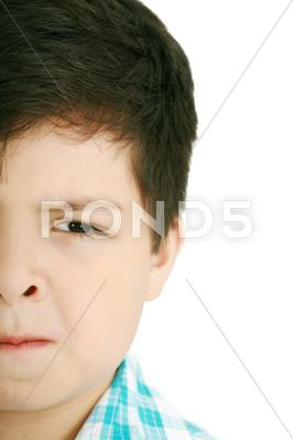 Stock photo of worried little boy isolated on a white background