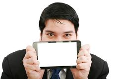 Young businessman holding a touch pad tablet pc on isolated white background Stock Photos