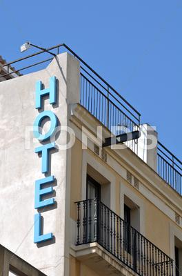 Stock photo of hotel sign on old building