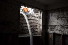House flood pumper hose through window 2080.jpg - stock photo