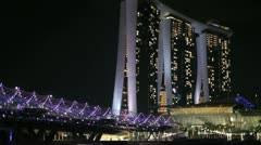 The Marina Bay Sands hotel & Helix bridge in Singapore Stock Footage