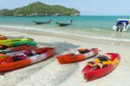 Tropical beach and canoe Stock Photos