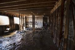 Home water mud basement flood damage 1922.jpg Stock Photos