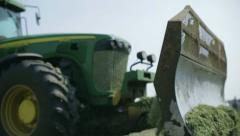 Tractors harvest hay for livestock 2 Stock Footage