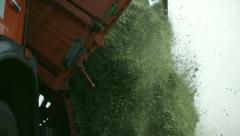 Tractors harvest hay for livestock 3 - stock footage