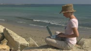 Beautiful woman working on laptop on the beach, businesswoman, business, sea, Stock Footage