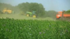 Tractors harvest hay for livestock 5 - stock footage