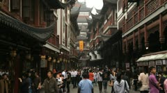 People shopping in the Yuyuan garden in Shanghai - stock footage