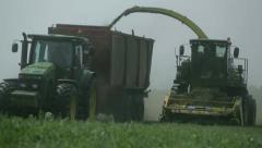 Tractors harvest hay for livestock 6 - stock footage