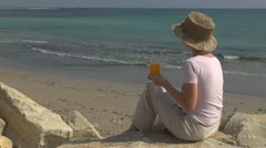 Beautiful woman drinking a delicious juice on the beach, relax, sea holiday girl Stock Footage