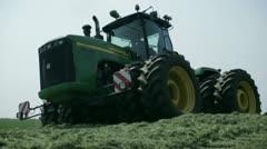 Tractors harvest hay for livestock 10 - stock footage