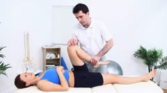 Physiotherapist manipulating a knee - stock footage