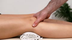 Physiotherapist massaging the knee of his patient Stock Footage