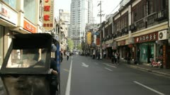 Speeding through the Shanghai streets on a rickshaw Stock Footage