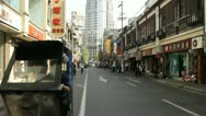 Stock Video Footage of Speeding through the Shanghai streets on a rickshaw