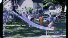 KIDS at Play on Slide PLAYGROUND FUN Children 1960s Vintage Film Home Movie 3238 Stock Footage