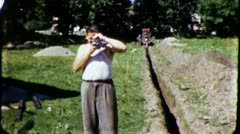 Man With MOVIE Camera Construction Site Ditch 1960s Vintage Film Home Movie 3246 Stock Footage