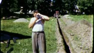 Stock Video Footage of Man With MOVIE Camera Construction Site 1960 (Vintage 8mm Film Home Movie) 3246