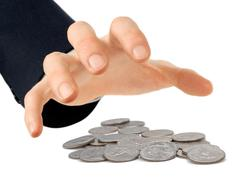 hand reaching for coins - stock photo
