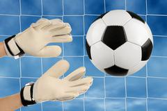 Soccer goalie's hands in action Stock Photos
