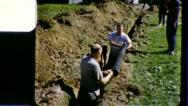 Stock Video Footage of Men Lay Pipe DIGGING SEWER Construction 1950s (Vintage Film Home Movie) 3249