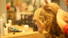 Blonde Woman Having Hair Done at Salon Combing Hair - stock footage