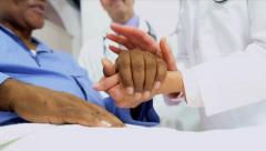 Medical Consultants Reassuring Patient - stock footage