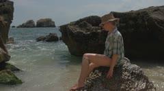 Beautiful woman relaxing on water coastline in ocean sea rock girl lifestyle  - stock footage