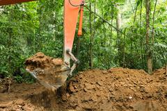 Earth mover in forest Stock Photos