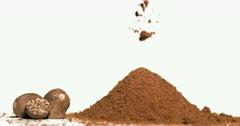 Nutmeg powder falling in super slow motion - stock footage
