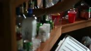 Stock Video Footage of Bartender Mising drinks for Customer behind Bar