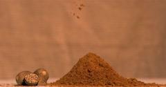 Super slow motion of nutmeg powder falling - stock footage