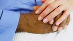 Hospital Consultant Reassuring Patient - stock footage