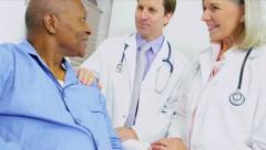 Medical Consultants Reassuring Patient Stock Footage
