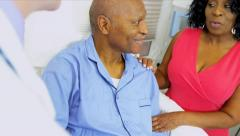 Doctor Treating Senior Male Patient Stock Footage