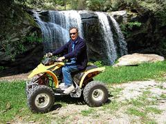 Man Riding ATV - stock photo