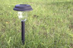 Solar power garden light Stock Photos