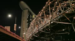 The Marina Bay Sands hotel & Helix bridge in Singapore Stock Footage