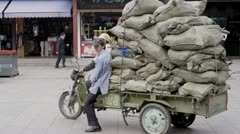 Overloaded Tuktuk in China Stock Footage