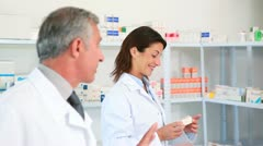 Female pharmacists with a colleague - stock footage