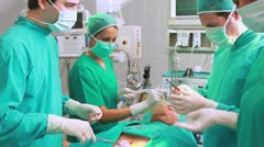 Surgeon cutting at patient belly Stock Footage